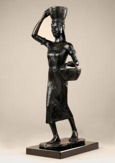 Barthe's bronze sculpture of a woman carrying a basket on her head and under her arm.