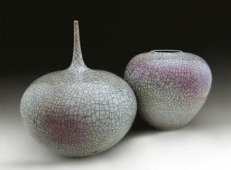 Two of Lee's vases made from porcelain with a purple and green glaze.