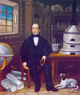 Oil on canvas of a man sitting in an laboratory with his dog.