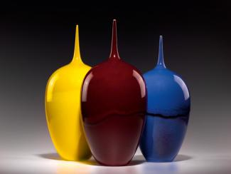 An image of three of Lee's porcelain objects all similar in shape, but differ in glaze.