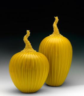 An image of two of Lee's prickly melons with a yellow glaze.