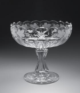 An image of a cut and engraved glass compote bowl.