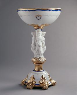 An image of a porcelain and parian ware centerpiece with gold decorations.