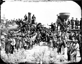 Russell's ambrotype of rail workers lined up on two sides and two shaking hands in the middle.