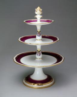 An image of a porcelain dessert stand with three tiers.