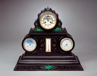 An image of a marble and malachite mantel clock.
