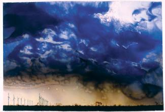 Rockman's oil painting of a rain storm over windmills.