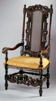 An image of Davenport's white oak and cane armchair with yellow seat cushion.