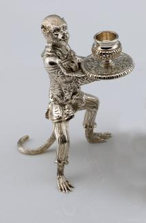 An image of Vitali's silver candlestick holder in the shape of a monkey.