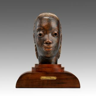 Johnson's copper and wood bust.