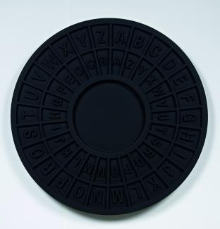 A photograph of a black circular object.