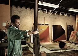 A photograph of Sam Gilliam inside a studio.