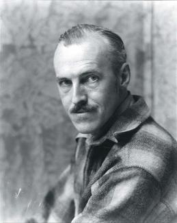 A photograph of man in a plaid shirt.
