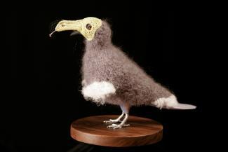 A crocheted dodo bird.