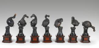 A photograph of seven sculpted dodo birds.
