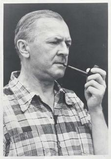 A photo of a man smoking a pipe.