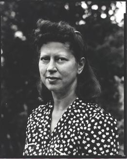 A photograph of a woman in a black and white shirt.