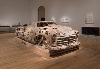 A gallery shot of an unfired clay car.