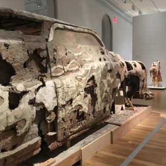 A detail shot of an unfired clay car.
