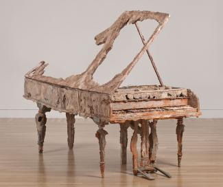 A piano made from unfired clay.