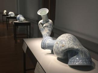 Gallery shot of five porcelain vases.