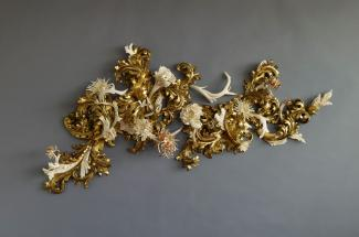 Wood fragments and antler, bone, and teeth painted in gold.