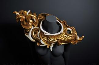A neckpiece made of antlers and boars' tusks painted gold.
