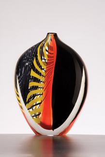 A black, orange, and yellow glass vessel.
