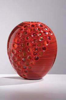 A red glass vessel.