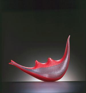 A red and clear glass object.
