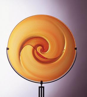 An orange glass circular object.