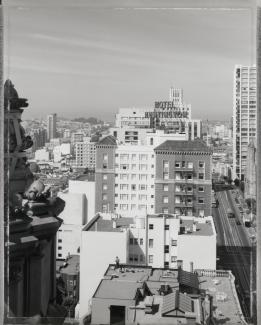A photograph taken from the roof of a building looking out into the neighborhood.