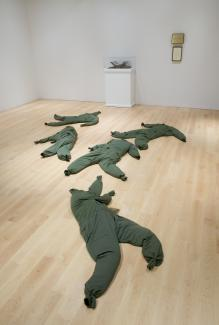 An image of green clothing laying on the gallery floor.