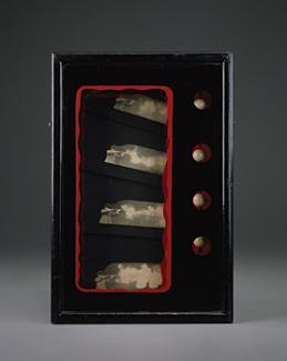 A box with four artifacts inside.