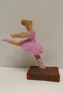 An artwork of a figure dancing in a pink dress.