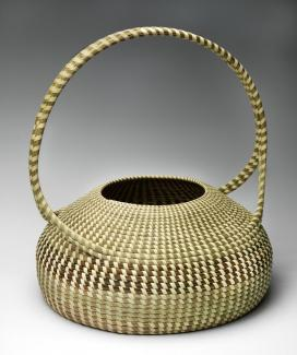A woven basket with a handle.