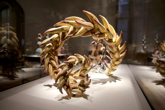 A detailed photograph of a yellow twisting sculpture.
