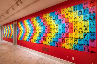 A photograph of a colorful wall with artwork on it