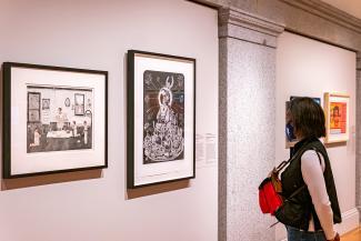 A photograph of a person inside an art museum.