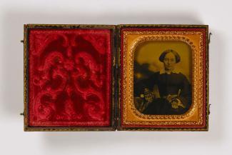 A ambrotype shows Mrs. Glenalvin Goodridge sitting down