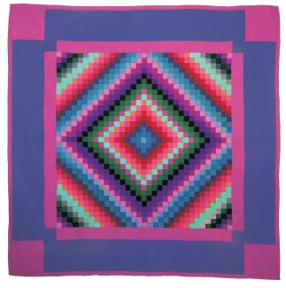 A quilt with a diamond center and a border in purple and pink colors.