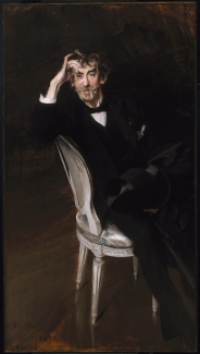 A portrait of James McNeill Whistler dressed in a black suit and seated in a chair.