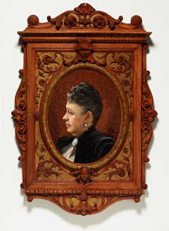 A portrait of a woman in a black dress made from glass mosaic tiles in an ornate wooden frame.