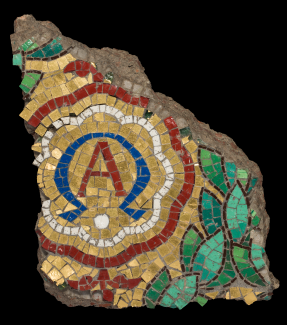 A fragments of a mosaic showing a cluster of leaves and the letter A.