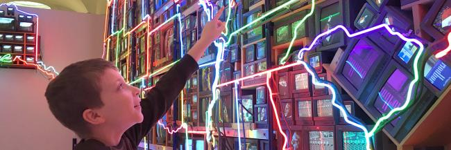 Student in front of Nam June Paik's Electronic Superhighway