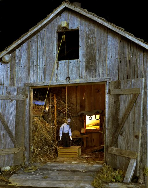 A photograph of a nutshell study of unexplained death showing a man's death by hanging inside a barn. (5 of 26)