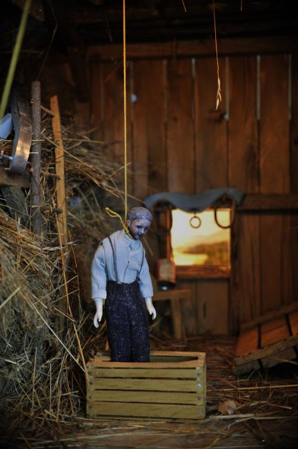 A photograph of a nutshell study of unexplained death showing a detail of a man's death by hanging inside a barn. (6 of 26)