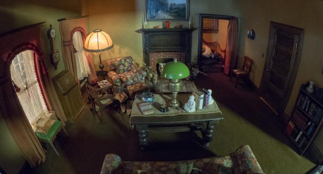 A photograph of a nutshell study of unexplained death showing a detail of a a living room. (18 of 26)