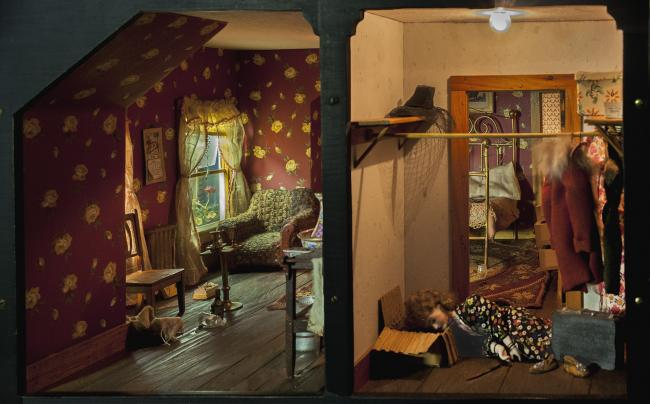 A photograph of a nutshell study of unexplained death showing a detail of a bedroom. (17 of 26)
