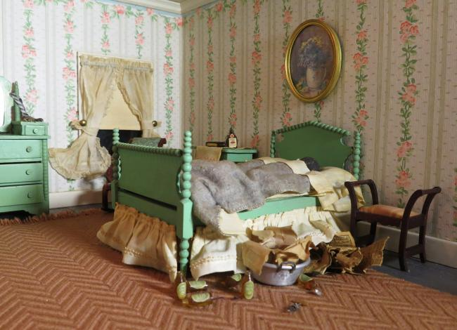 A photograph of a nutshell study of unexplained death showing a detail of a bedroom. (11 of 26)